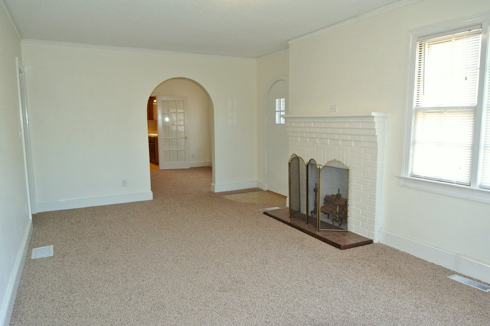Den with Fireplace, Arched Doorway